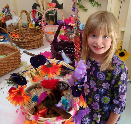 A camper proudly displays the fairy basket, fairy finger puppets,